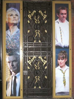 Cast photos at the entrance to the Phoenix Theatre.
