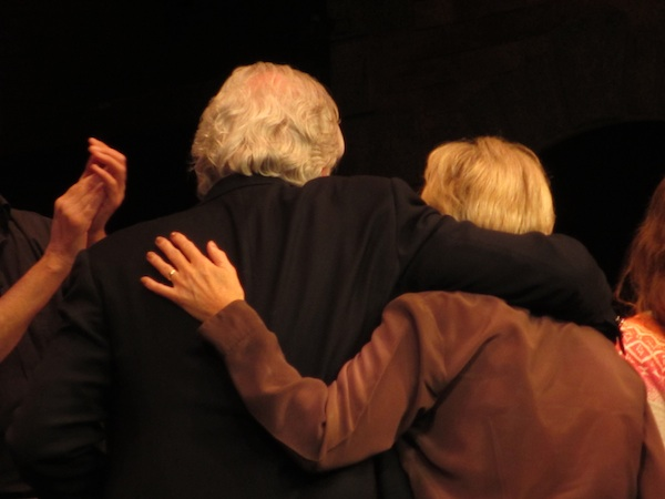 Bill Kenwright and Lyn Paul leave the stage with their arms around each other.