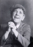 Picture of Norman Wisdom from the 1990 UK tour programme.